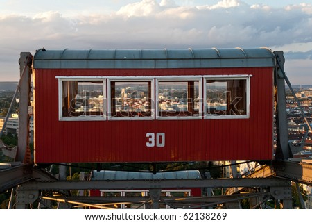 The big Viennese ferris wheel cabin up in the sky - stock photo