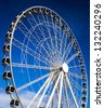 The big wheel with blue sky - stock photo