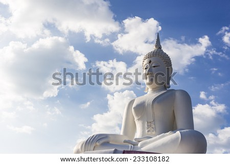 The big white buddha statue and face of peacefull look like Buddha enlighten time. The hard light look like good and bad in people. - stock photo