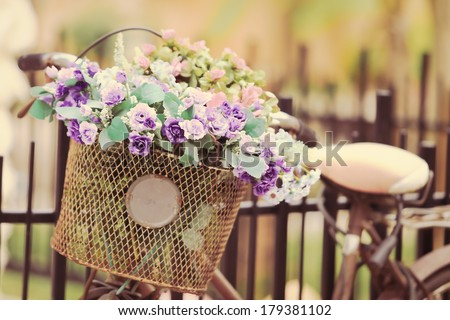 The bike basket with roses with retro filter effect - stock photo