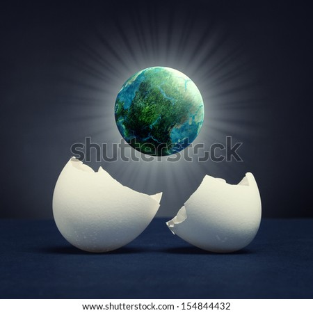 The birth of a new planet out of the egg. - stock photo