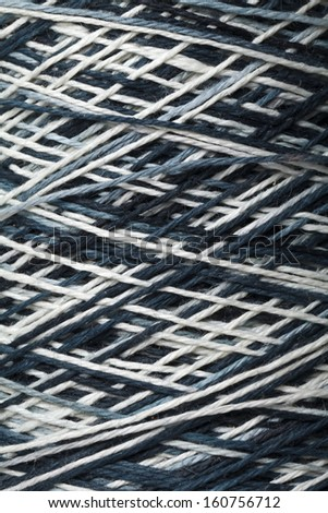 The black and white yarn used for knitting clothes - stock photo