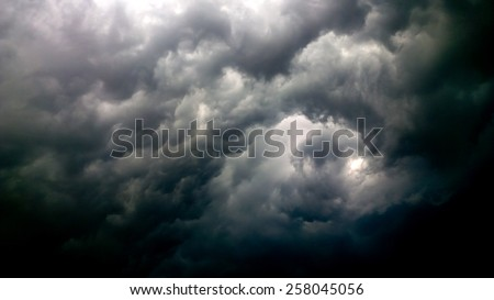 The black cloud is stronger storm - stock photo