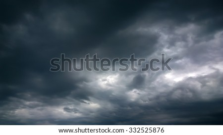 The black cloud of storm in come - stock photo