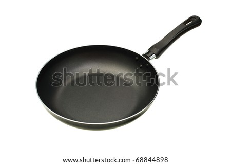 The black frying pan is isolated on a white background