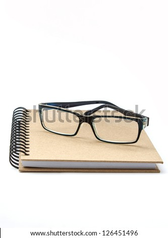 The black glasses on note book