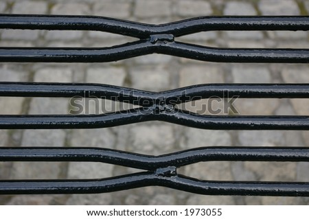 The black metal bars / slats comprising the seating area of a street furniture bench in Liverpool.