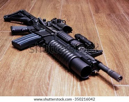 The Black Rifle On The Floor - stock photo