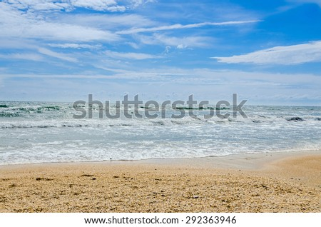 The Black Sea beach with sand and water, blue sky clouds, seaside - stock photo