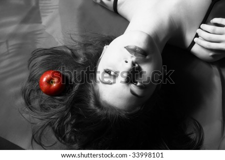 The black-white image of the girl with the dismissed hair and a red apple.