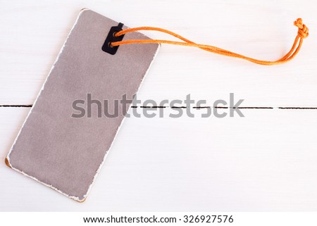 The blank price tag label on white wooden background close-up - stock photo