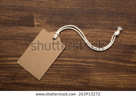the blank price tag label on wooden background close up - stock photo