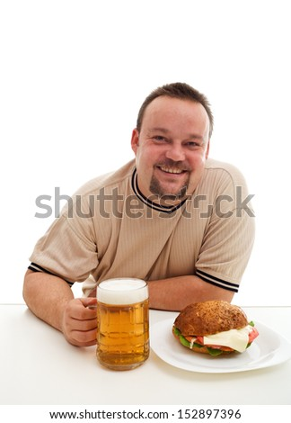 The bliss of ignorance - happy junk food consumer with hamburger and beer - stock photo