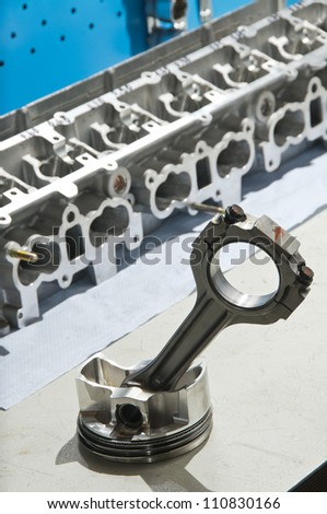 The block of cylinders from the engine of a sports car on a workshop table - stock photo