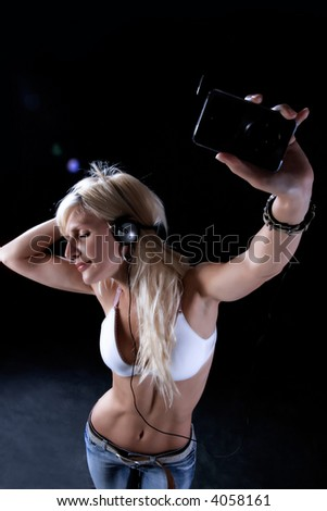 the blond girl is enjoying in music - stock photo