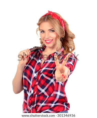 The blonde holds a wrench on a white background