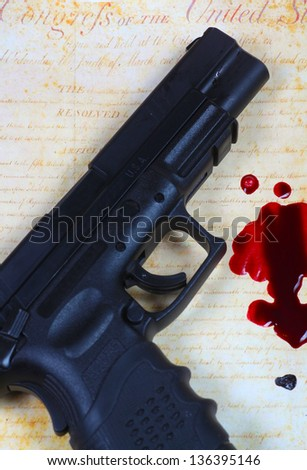 The Blood of Patriots/Automatic pistol & blood splatter against copy of US Bill of Rights - stock photo