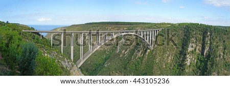 The Bloukrans Bridge is the highest bridge in Africa, road bridge with a bungee jumping platform, deep gorge in the Indian Ocean, landscape along the Garden Route in South Africa, Panorama/Arch bridge - stock photo