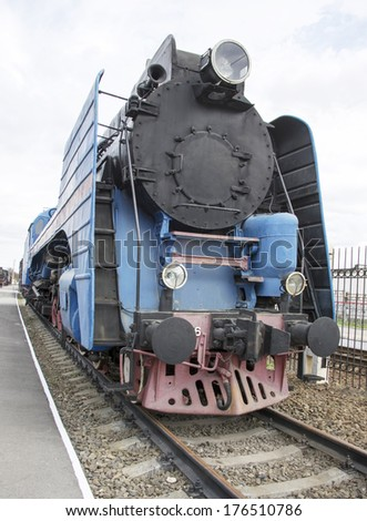 The blue express steam locomotive which is accelerating momentum 125 km/hour