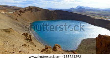 The blue lake in the Viti crater in the Krafla region, northeast Iceland. Panorama - stock photo
