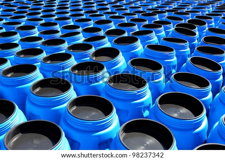 The blue plastic barrels for storage of chemicals - stock photo