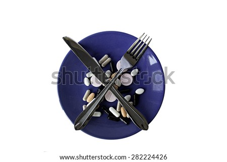 The blue plate with a set of pills - stock photo