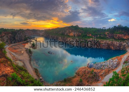 The blue quarry during sunset - stock photo