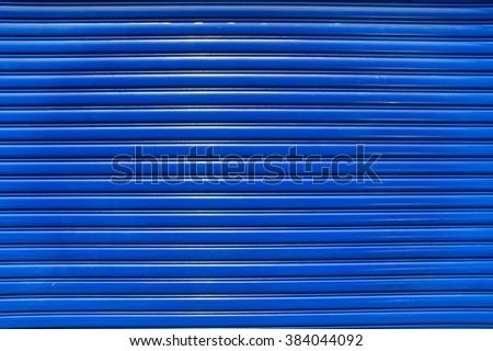 The Blue Roll-Up Door - stock photo