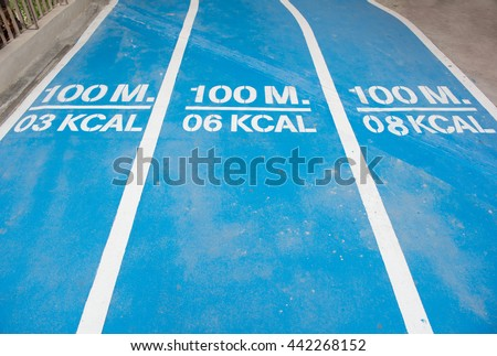 The blue running track with Distance and calories on the mall - stock photo
