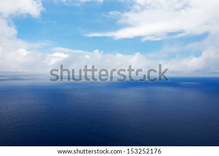 The blue sea and a cloudy sky