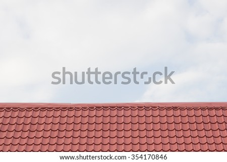 The Blue sky and brid on the house roof top - stock photo