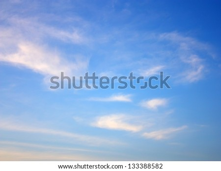 The blue sky and clouds in a summer day - stock photo