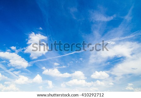 The blue sky with clouds, background - stock photo