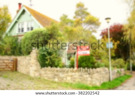 The blurry photo of house selling advertising signage represent the house selling business and real estate concept related idea.   - stock photo