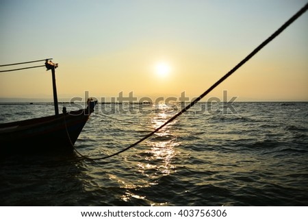 the boat and sun light in the morning in Thailand sea