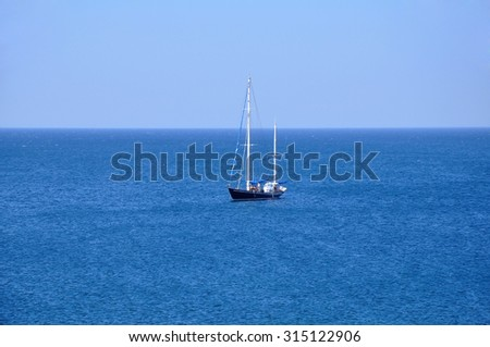 The boat on the middle of the sea