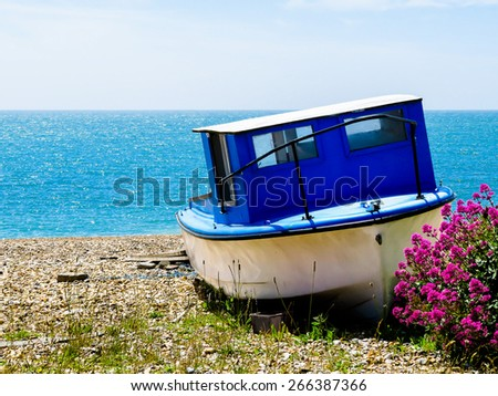 The boat on the sea coast of English Channel - stock photo