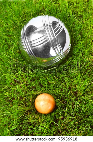 The bocce balls on a green grass. Close up with shallow dof. - stock photo