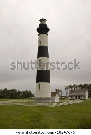 The Bodie Island Lighthouse in the Outer Banks of North Carolina set against a stormy sky.