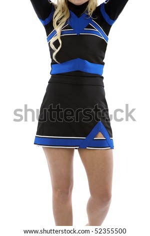 The body of a standing cheerleader with her arms up - stock photo