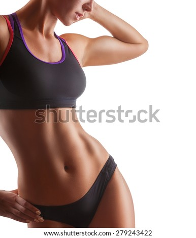 The body of a young athletic girl isolated on a white background - stock photo