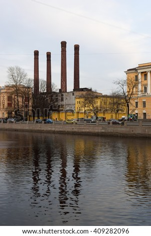 The boiler house chimney on the embankment of the river Fontanka in St. Petersburg