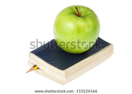 The book and an apple. On a white background. - stock photo