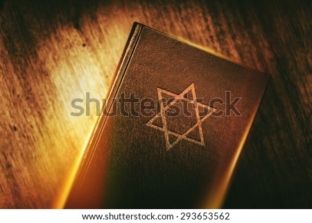 The Book of Judaism. Ancient Prayer Book with Judaism Star of David Symbol on Cover. - stock photo
