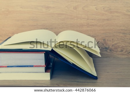 The book on an old brown wooden background