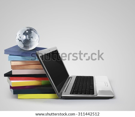 The books and a laptop - stock photo