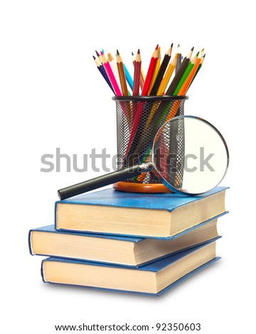 The books, pencils, and magnifying glass on white - stock photo
