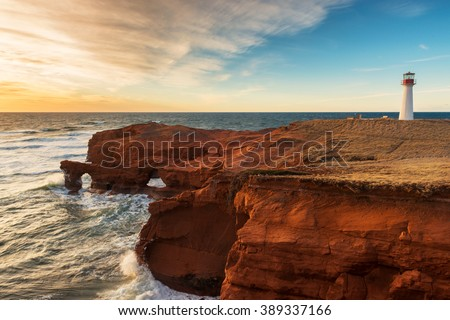 The Borgot lighthouse and the beautiful red cliffs of Magdalen Islands, Quebec, Canada