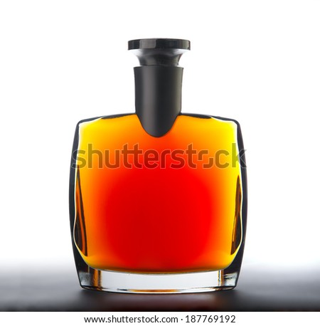 The bottle of brandy (cognac). Isolated on white. - stock photo