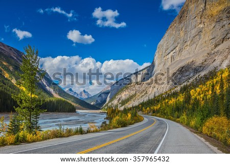 The Bow River Canyon in September.  Canadian Rockies, Great Banff. Excellent highway and surrounded by autumnal woods - stock photo